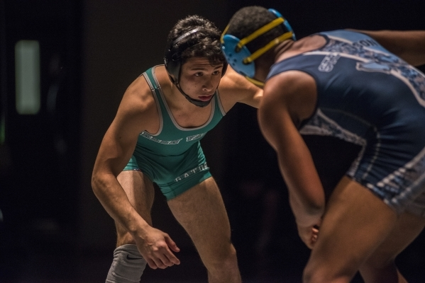 Green Valley's Giullian Nakamatsu, left, wrestles Canyon Spring WIlliam Stevenson during their 145 lbs. championship match at the Division 1 Sunrise Region wrestling meet at the Green Valley ...