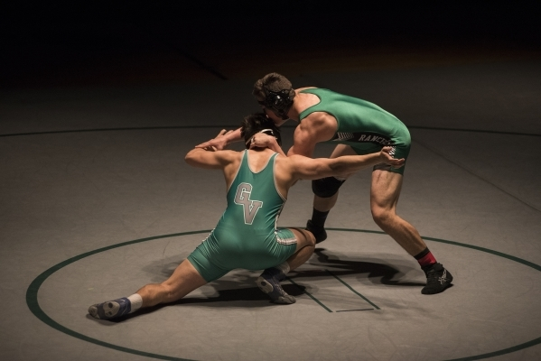 Green Valley's Robert Razo, left, wrestles Rancho's Alejandro Ordonez during their 182 lbs. championship match at the Division 1 Sunrise Region wrestling meet at the Green Valley high  ...