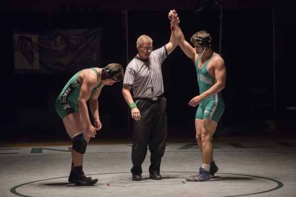 The referee raises Green Valley's Robert Razo's hand, right, after defeating Rancho's Alejandro Ordonez during their 182 lbs. championship match at the Division 1 Sunrise Region  ...