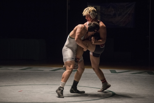 Green Valley's Sal Hicks, left, wrestles Las Vegas High's Cruz Littlefield during their 195 lbs. championship match at the Division 1 Sunrise Region wrestling meet at the Green Valley  ...