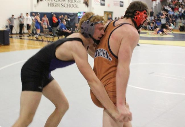 Durango 152 pounder Jacob Bourgault works Legacy's Jacob Brents back into the circle, during their consolation match of the Division I Sunset Region Tournament at Shadow Ridge on Friday. Bou ...
