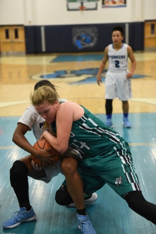 Rancho's Samantha Pochop (44) battles for a rebound against Canyon Springs Alexia Thrower (20) during the Sunrise Regional quarterfinal basketball game played at the Canyon Springs gym in No ...