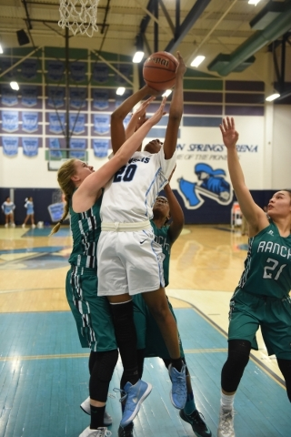 Canyon Springs Alexia Thrower (20) goes up for a shot against Rancho's Samantha Pochop (44) during the Sunrise Regional quarterfinal basketball game played at the Canyon Springs gym in North ...