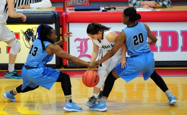 Foothill  guard Amanda Carducci, center, loses control of the ball in front of Canyon Springs guard KeAjanae Haley (13) and forward Alexia Thrower (20) in the fourth quarter of their prep basketba ...