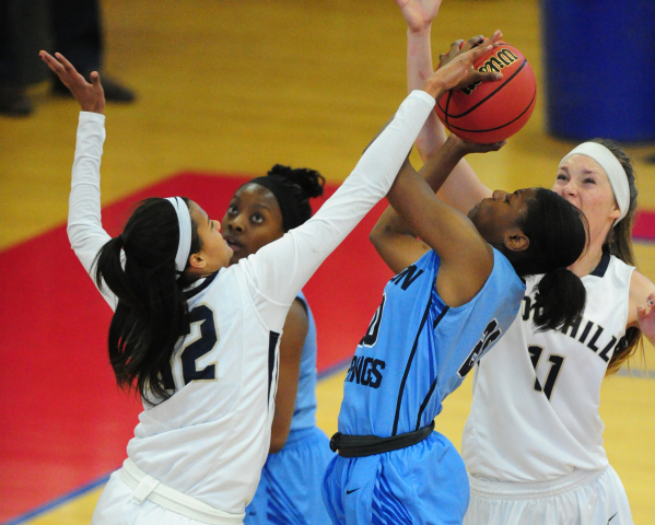Foothill guard Rae Burrell (12) blocks the shot of Canyon Springs forward Alexia Thrower (20) in the fourth quarter of their prep basketball game at Liberty High School in Henderson Thursday, Feb. ...