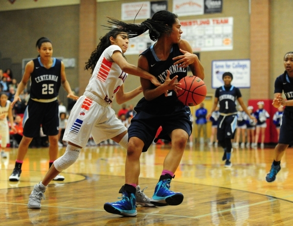 Bishop Gorman guard Ciara Young, left, pokes the ball away from Centennial guard Bailey Thomas (24) in the fourth quarter of their prep basketball game at Arbor View High School in Las Vegas Frida ...