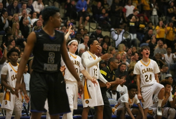 The Clark High School bench celebrates a three point shot during the I-A Southern boys basketball final at Desert Pines High School in Las Vegas, on Saturday, Feb. 20, 2016. Desert Pines won 47-42 ...