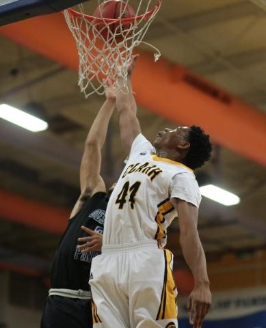 Clark High School senior Darius Jackson (44) and Desert Pines High School junior Trevon Abdullah (3) fight for a rebound during the I-A Southern boys basketball final at Desert Pines High School i ...