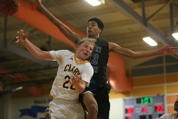 Clark High School sophomore Trey Woodbury (22) and Desert Pines High School jr. Greg Floyd junior (13) battle for a rebound during the I-A Southern boys basketball final at Desert Pines High Schoo ...
