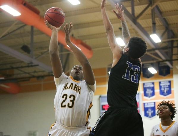 Clark High School freshman Antwon Jackson (23) shoots the ball over Desert Pines High School jr. Greg Floyd junior (13) during the I-A Southern boys basketball final at Desert Pines High School in ...