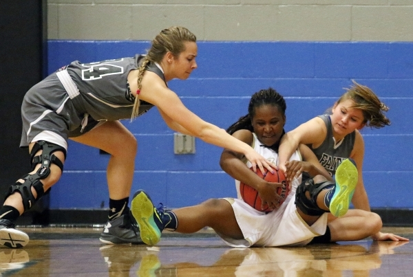 Spring Valley´s Kalynn Lesley, center, struggles for possession of the ball with Faith Lutheran´s Heather Hersh, left, and Bobbi Tharaldson during a NIAA Division 1-A Southern Region girls c ...