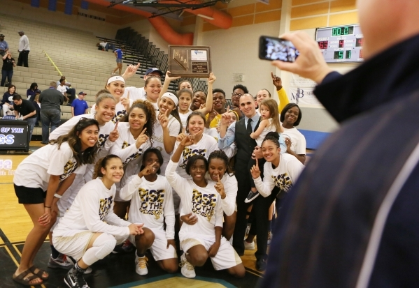 Spring Valley girls basketball team takes a personal photo after winning the NIAA Division 1-A Southern Region girls championship basketball game at Desert Pines High School Saturday, Feb. 20, 201 ...