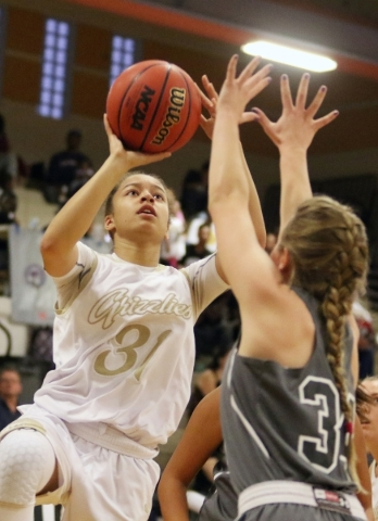 Spring Valley´s Ella Zanders, left, goes for a layup near Faith Lutheran´s Heather Hersh during a NIAA Division 1-A Southern Region girls championship basketball game at Desert Pines High Sc ...