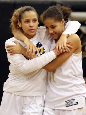 Spring Valley´s  Essence Booker, left, and Kayla Harris embrace after their team won the NIAA Division 1-A Southern Region girls championship basketball game at Desert Pines High School Saturda ...