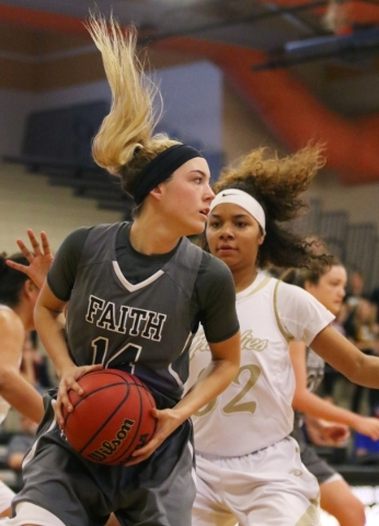 Faith Lutheran´s Sam Caruth, left, grabs a rebound near Spring Valley's Lynnae Wilds during a NIAA Division 1-A Southern Region girls championship basketball game at Desert Pines High Sch ...