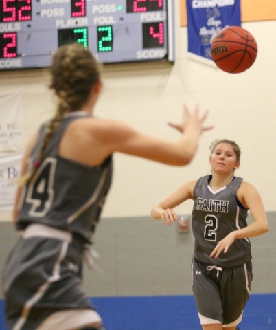 Faith Lutheran´s Bobbi Tharaldson, right, passes the ball to Heather Hersh during the NIAA Division 1-A Southern Region girls championship basketball game against Spring Valley at Desert Pines  ...
