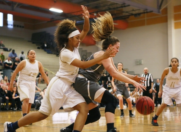Spring Valley´s Lynnae Wilds, left, guards Faith Lutheran´s Maddy Larson during a NIAA Division 1-A Southern Region girls championship basketball game at Desert Pines High School Saturday, F ...