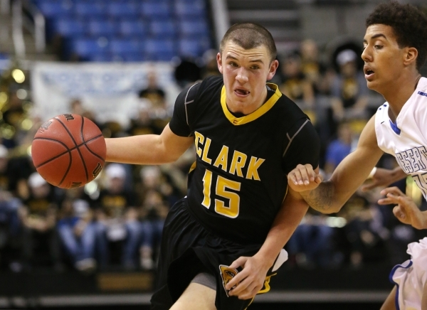 Clark's James Bridges drives past Desert Pines' Greg Floyd during the NIAA Division I-A state basketball championship in Reno, Nev. on Saturday, Feb. 27, 2016. Clark won 43-39. Cathlee ...
