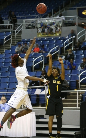 Clark's Keyshaun Webb shoots over Desert Pines defender Curtis Henderson during the NIAA Division I-A state basketball championship in Reno, Nev. on Saturday, Feb. 27, 2016. Clark won 43-39. ...