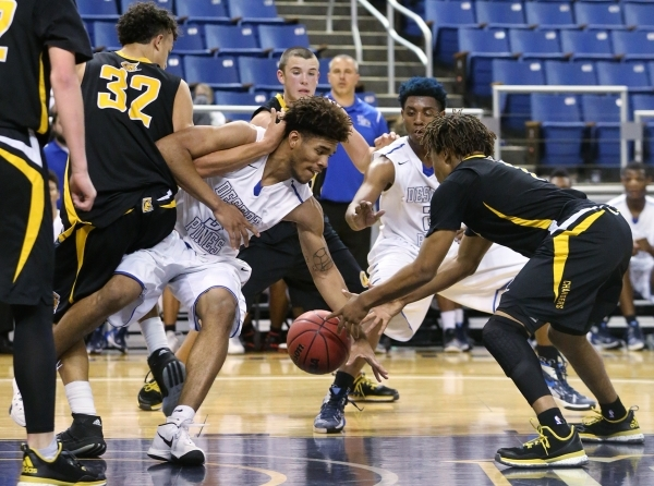 Desert Pines' Trevon Abdullah-Booker and Clark's Keyshaun Webb fight for a loose ball during the NIAA Division I-A state basketball championship in Reno, Nev. on Saturday, Feb. 27, 201 ...