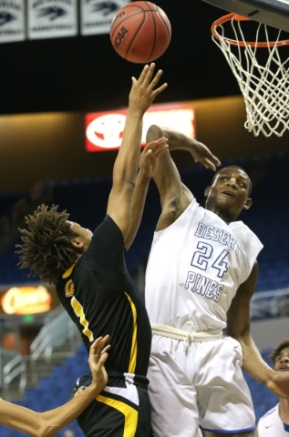 Desert Pines' Randal Grimes goes up to block a shot from Clark's Keyshaun Webb during the NIAA Division I-A state basketball championship in Reno, Nev. on Saturday, Feb. 27, 2016. Clar ...
