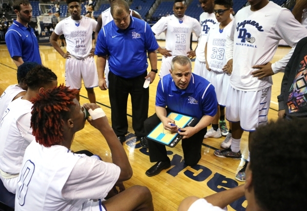 Desert Pines Head Coach Mike Uzan talks to his team during a timeout in the NIAA Division I-A state basketball championship game against Clark in Reno, Nev. on Saturday, Feb. 27, 2016. Clark won 4 ...