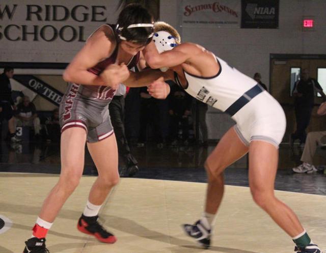 Cimarron-Memorial's Daniel Rodriguez (left) and Shadow Ridge's Alika Villatora lock up at the start of their 120-pound championship match of the Division I Sunset Region Tournament at  ...
