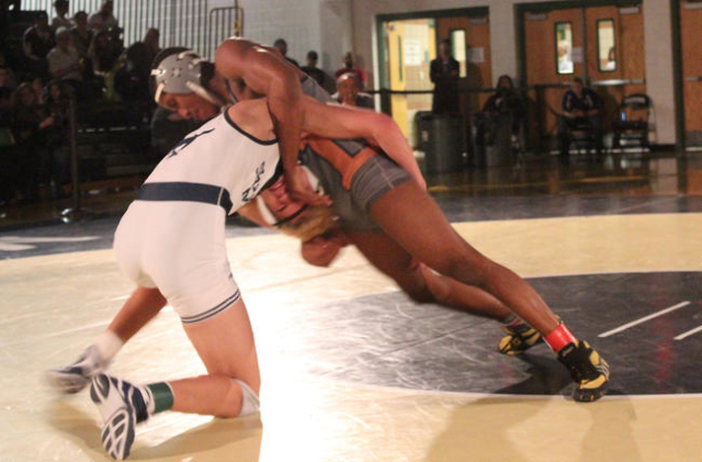 Legacy's Dion Jones blocks a shot by Shadow Ridge's Jamison Rand, during their 138-pound championship match of the Division I Sunset Region Tournament at Shadow Ridge on Saturday. W.G. ...