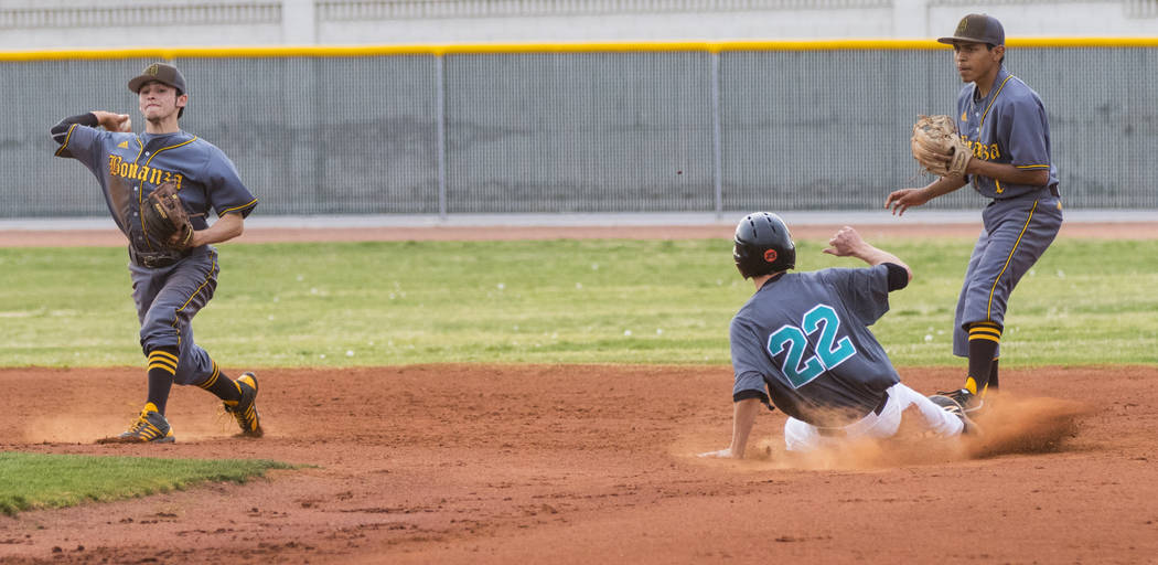Silverado pitcher Tyler Paasche (22) slides into second base in the second inning during a baseball game against Bonanza High School at Silverado High School in Henderson on Friday, March 10, 2017 ...
