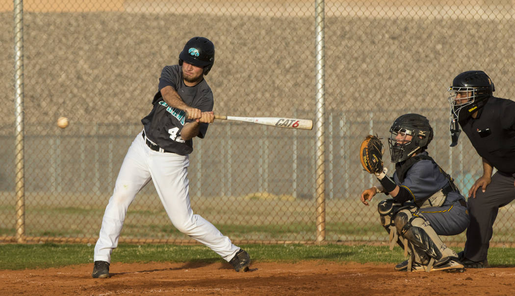 Silverado first baseman Michael Janosik (42) hits the ball in the fifth inning during a baseball game against Bonanza High School at Silverado High School in Henderson on Friday, March 10, 2017. S ...