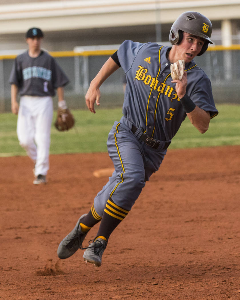 Bonanza second baseman Matthew Cox (5) runs for third base in the fifth inning during a baseball game against Silverado High at School Silverado High School in Henderson on Friday, March 10, 2017. ...