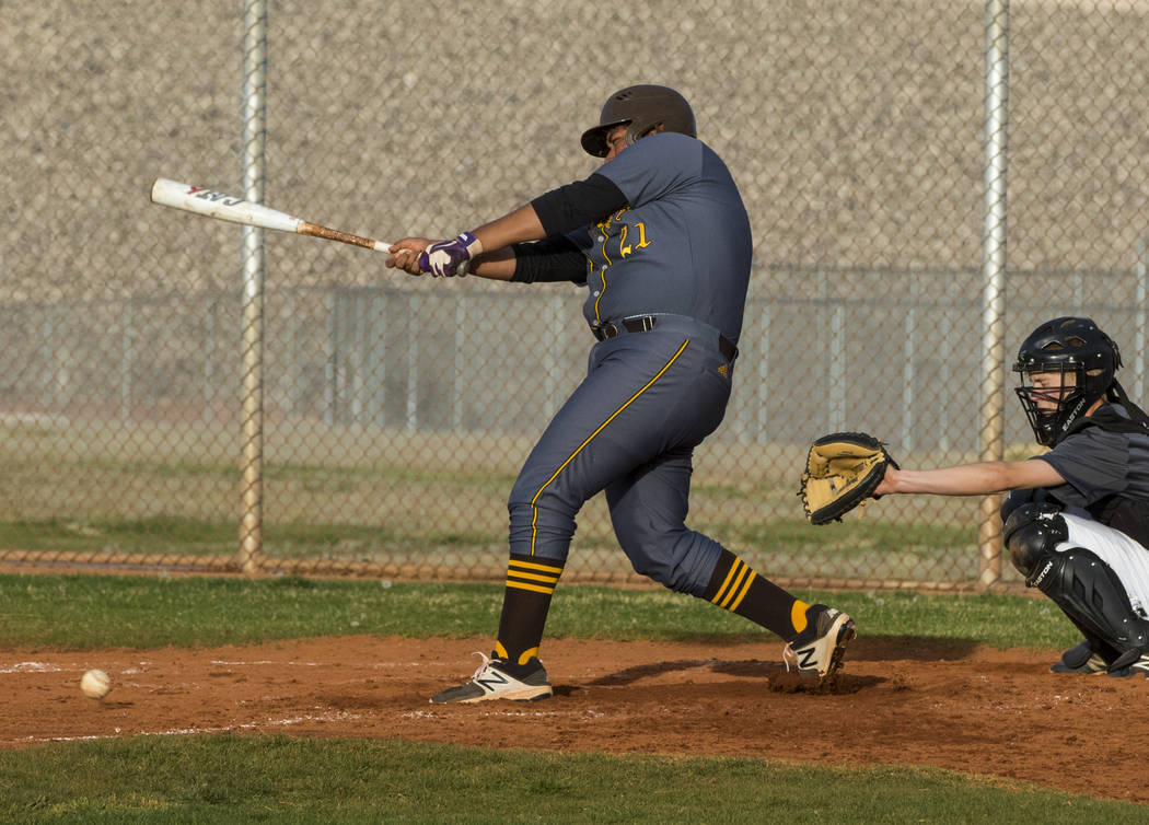 Bonanza first baseman Sebastian Rosales-Hernandez (21) hits a double in the fourth inning during a baseball game against Silverado High School at Silverado High School in Henderson on Friday, Marc ...