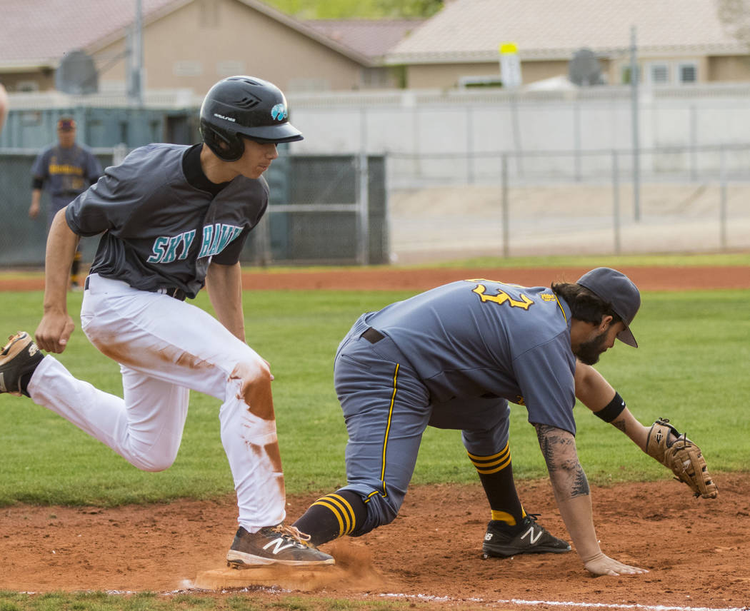Bonanza first baseman Danny Ruiz (13) tags Silverado pitcher Christian Hernandez (32) out in the second inning during a baseball game at Silverado High School in Henderson on Friday, March 10, 201 ...