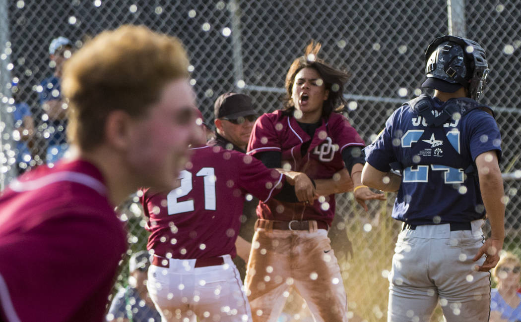 The Desert Oasis High School baseball team celebrates their win after the championship game of the Diamondback Kickoff Tournament against Centennial High School at Desert Oasis High School in Hend ...