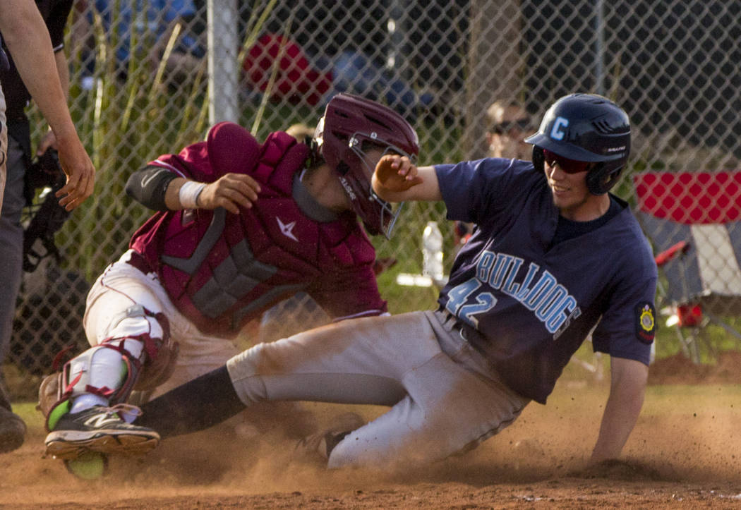 Centennial infielder Jake Rogers (42) slides into home plate during the championship game of the Diamondback Kickoff Tournament against Centennial High School at Desert Oasis High School in Hender ...