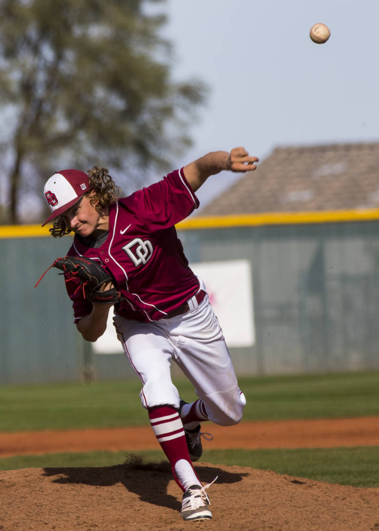 Desert Oasis pitcher Josh Sharman (5) throws during the third inning of the championship game of the Diamondback Kickoff Tournament against Centennial High School at Desert Oasis High School in He ...