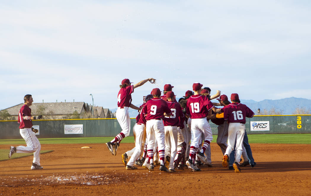 The Desert Oasis High School baseball team celebrates their win against Centennial High School after the championship game of the Diamondback Kickoff Tournament at Desert Oasis High School in Hend ...