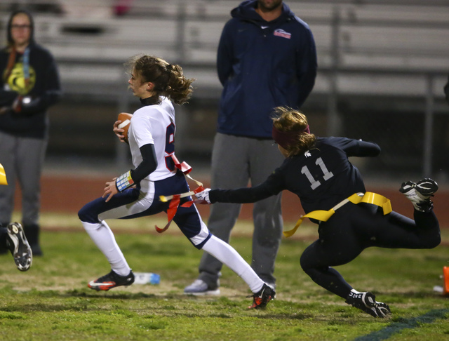 Coronado's Caitlin Shannon (9) is tagged out by Cimarron-Memorial's Maddison McCann during the Class 4A state championship flag football game at Cimarron-Memorial High School in Las Vegas on Wedne ...