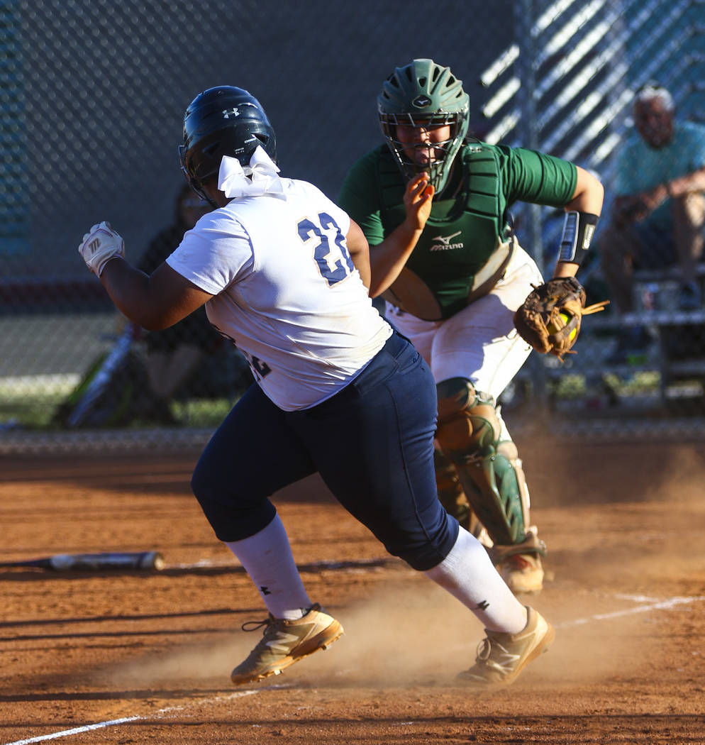 Shadow Ridge first baseman Alyssa Stanley (22) is tagged out while running back to third base by Palo Verde catcher Grace Chavez (25) during a softball game at Shadow Ridge High School in North La ...