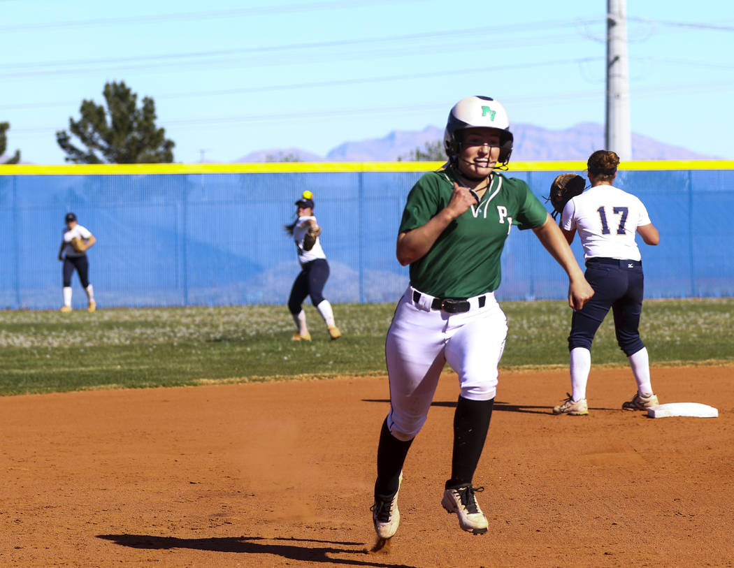 Palo Verde outfielder Makall Whetten (1) runs to third base after hitting a triple in the first inning during a softball game against Shadow Ridge High School at Shadow Ridge High School in North  ...