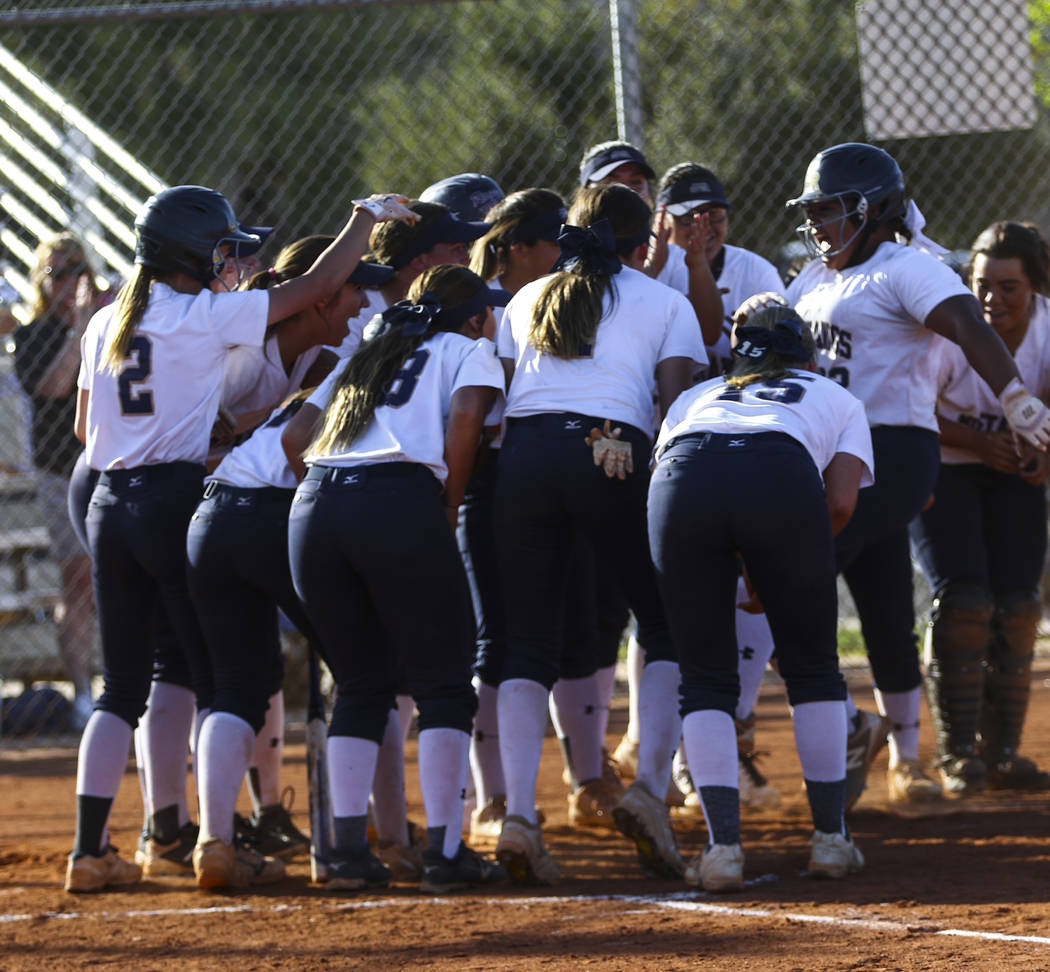 The Shadow Ridge softball team celebrates the home run hit by first baseman Alyssa Stanley (22) in the fifth inning during a softball game against Palo Verde High School at Shadow Ridge High Schoo ...