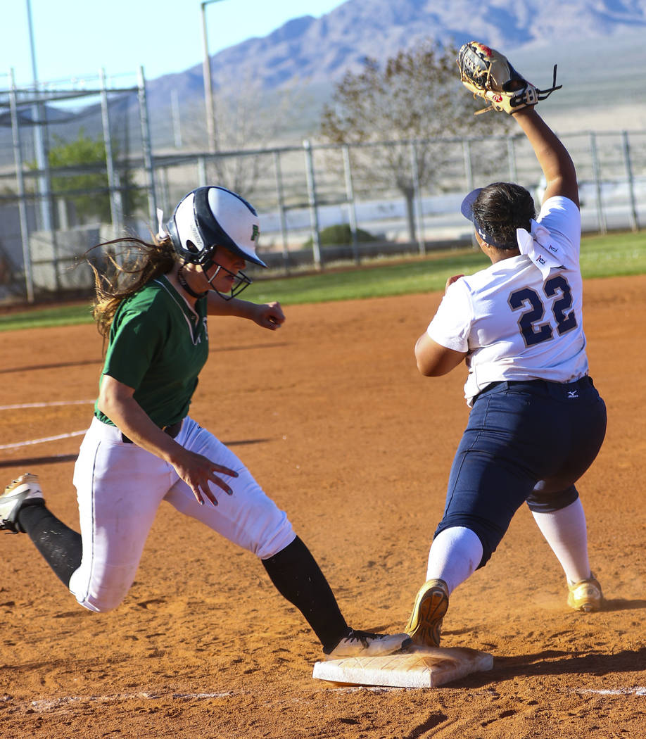 Shadow Ridge first baseman Alyssa Stanley (22) tags Palo Verde outfielder Makall Whetten (1) out at first base in the fifth inning during a softball game at Shadow Ridge High School in North Las V ...