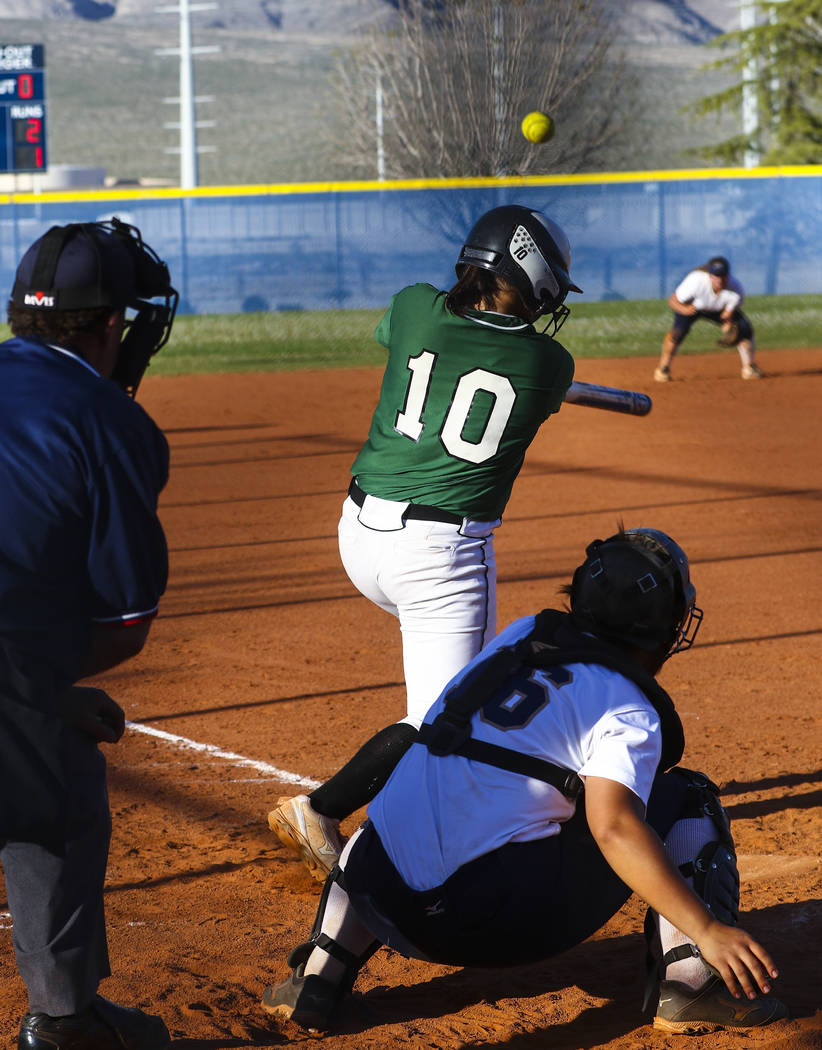 Palo Verde infielder Richmond Garcia (10) hits the ball in the sixth inning during a softball game against Shadow Ridge High School at Shadow Ridge High School in North Las Vegas on Monday, March  ...