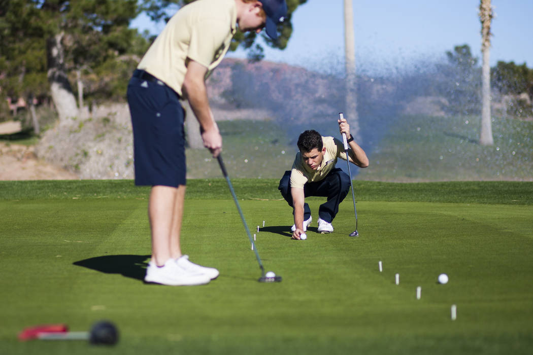 Foothill sophomore Noah MacFawn, right, lines up the shot while going through drills during practice at Chimera Golf Club in Henderson on Monday, March 6, 2017. (Chase Stevens/Las Vegas Review-Jou ...