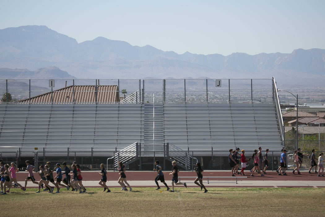 Track and field teammates warm up during a practice at Coronado High School on Tuesday, March 14, 2017, in Las Vegas. (Bridget Bennett/Las Vegas Review-Journal) @bridgetkb