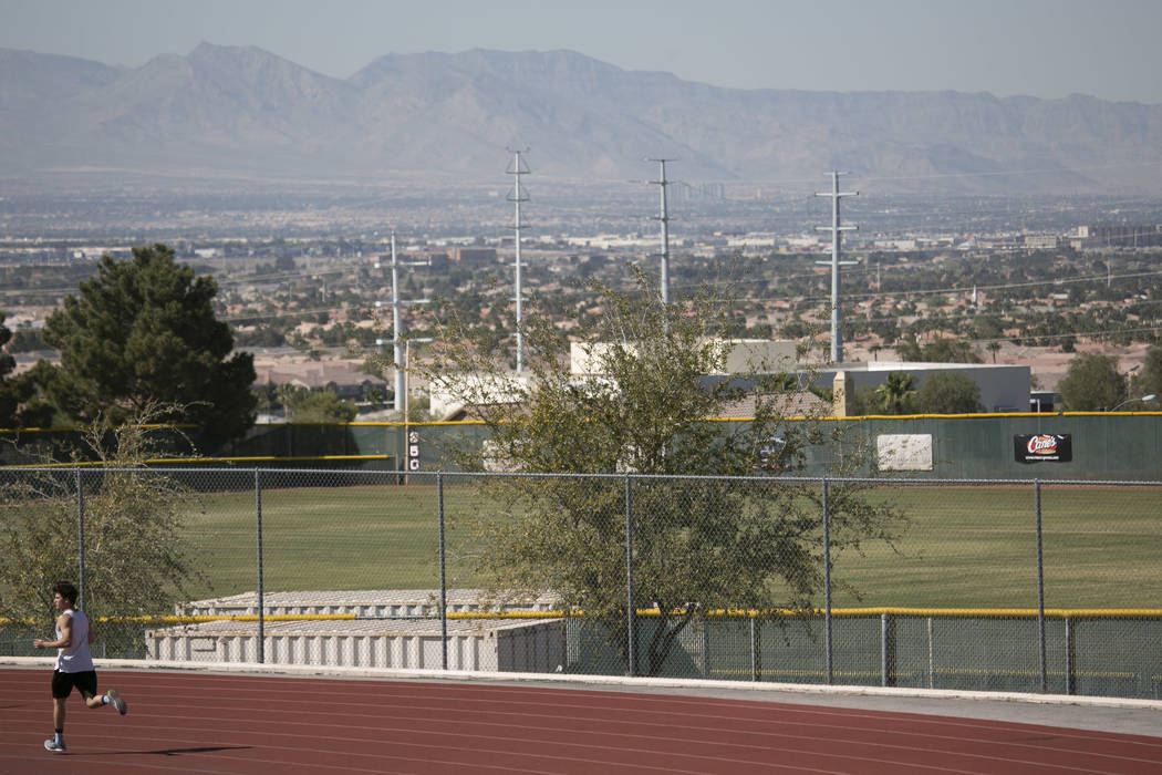 "Edward ""Teddy"" Andrews warms up prior to pole vaulting during a track and field practice at Coronado High School on Tuesday, March 14, 2017, in Las Vegas. (Bridget Bennett/Las Ve ..."