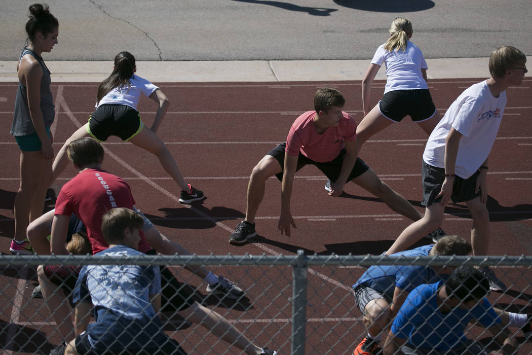 Garett Furlong, center, warms up with teammates during a track and field practice at Coronado High School on Tuesday, March 14, 2017, in Las Vegas. (Bridget Bennett/Las Vegas Review-Journal) @brid ...