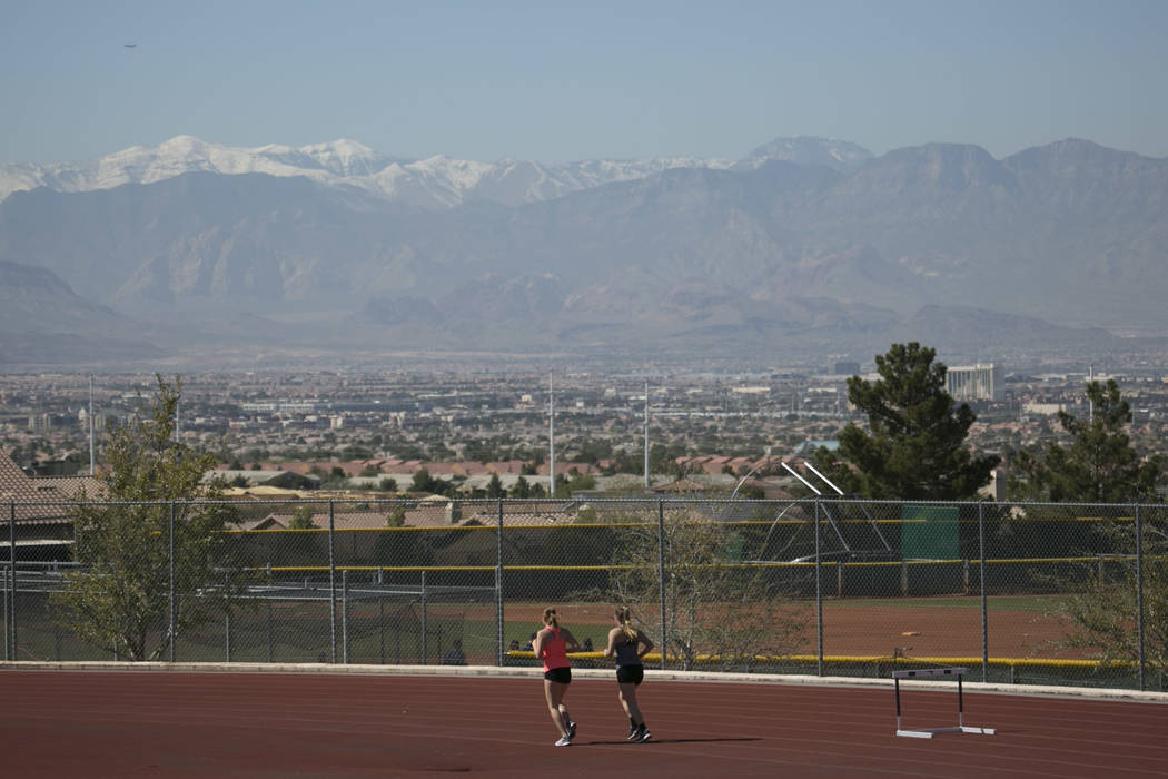 Track and field teammates warm up during a track and field practice at Coronado High School on Tuesday, March 14, 2017, in Las Vegas. (Bridget Bennett/Las Vegas Review-Journal) @bridgetkb