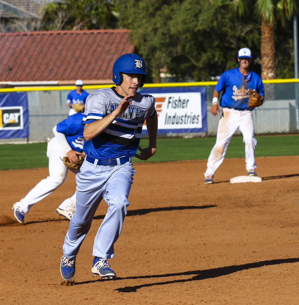 Basic second baseman Brady Clark (12) runs to third base in the sixth inning during a baseball game against Green Valley High School at Green Valley High School in Henderson on Wednesday, March 15 ...