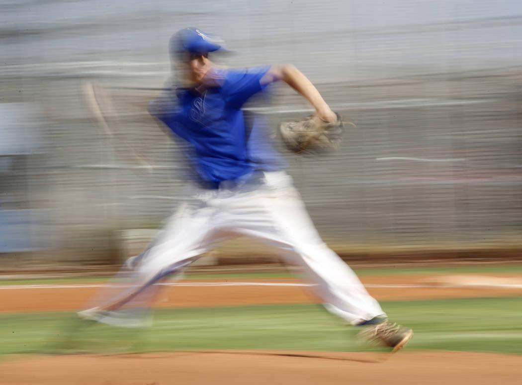 Sierra Vista's Alex Chavira (10) pitches during the second inning of a high school baseball game against Desert Oasis at Sierra Vista High School on Thursday, March 16, 2017, in Las Vegas. Desert  ...